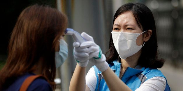 A South Korean health worker from a community health center wearing mask as a precaution against MERS,...