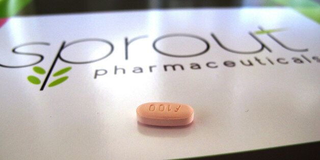 FILE - In this Friday, Sept. 27, 2013, file photo, a tablet of flibanserin sits on a brochure for Sprout...