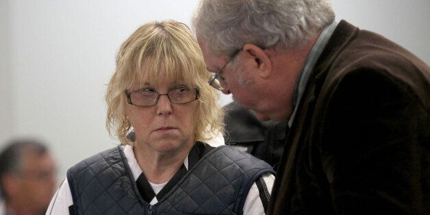 Joyce Mitchell stands with her lawyer Steven Johnston, appearing before Judge Buck Rogers in Plattsburgh...