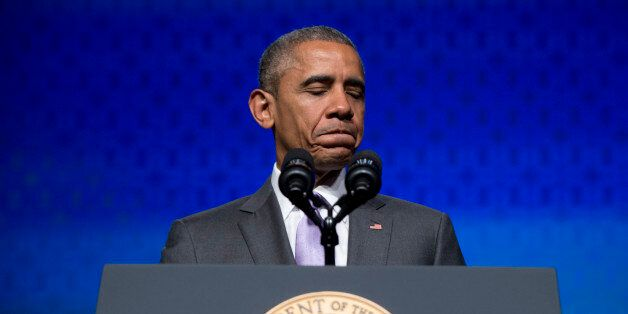 President Barack Obama pauses as he speaks to the Catholic Hospital Association Conference at the Washington...