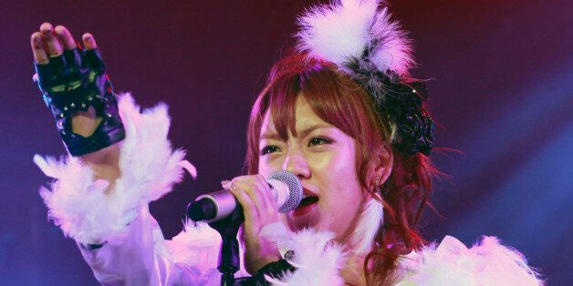 Member of Japanese idol group AKB48 Minami Takahashi performs during their live concert in Jakarta, Indonesia,...