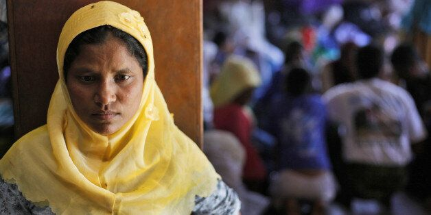 A Rohingya woman stands at a temporary shelter in Bayeun, Aceh Province, Indonesia, Monday, June 1, 2015....