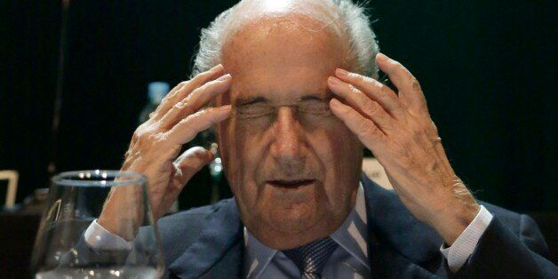 In this Wednesday, March 4, 2015 photo, FIFA President Sepp Blatter closes his eyes as he raises his...