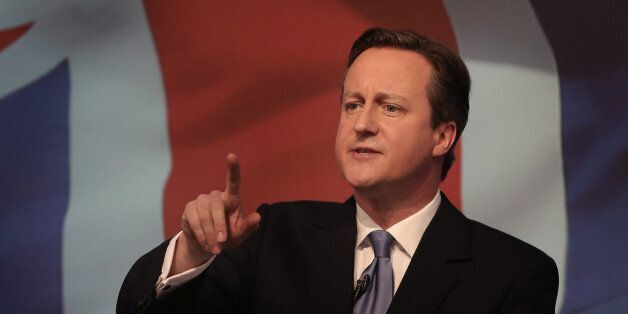 Britain's Prime Minister David Cameron gestures as he unveils the Conservative party manifesto, in Swindon,...