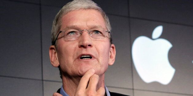 Apple CEO Tim Cook responds to a question during a news conference at IBM Watson headquarters, in New...