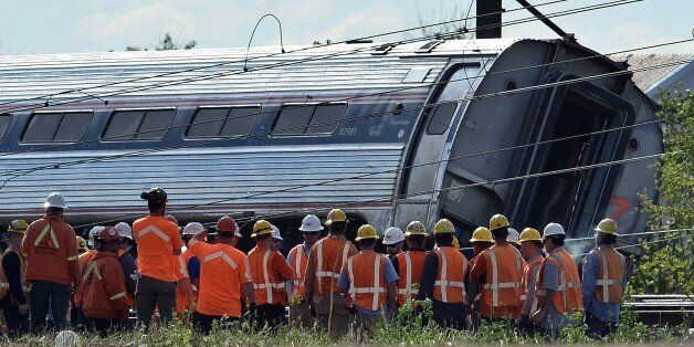 Rescuers gather around a derailed carriage of an Amtrak train in Philadelphia, Pennsylvania, on May 13,...