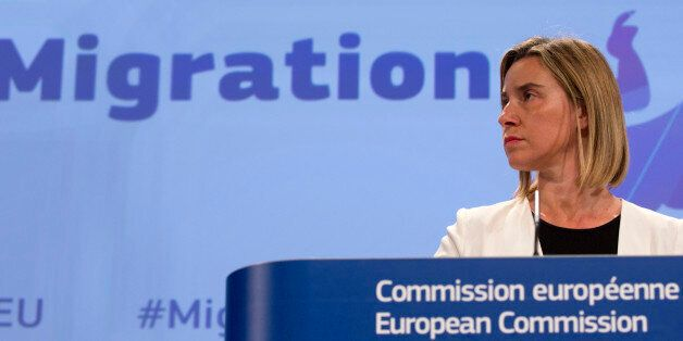 European Union High Representative Federica Mogherini listens to questions during a media conference...