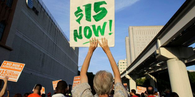 Protestors march in support of raising the minimum wage to $15 an hour as part of an expanding national...
