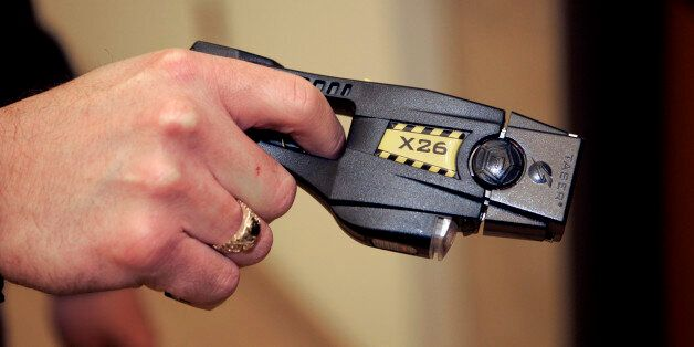 A Taser X26 stun gun is displayed at the Oakland Country Sheriff's office in Pontiac, Mich., Tuesday,...