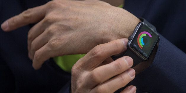 TOKYO, JAPAN - APRIL 24: A customer tries on an Apple Watch at a store on April 24, 2015 in Tokyo, Japan....