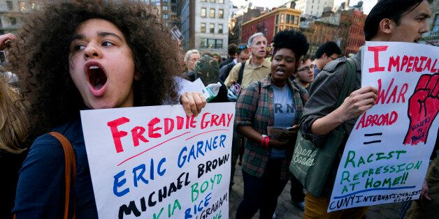 Protesters yell out in Union Square Wednesday, April 29, 2015, in New York. People gathered to protest...