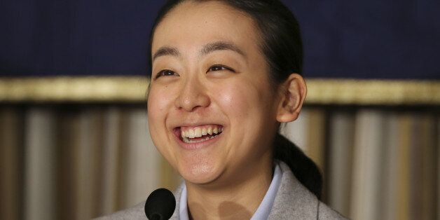 Japanese figure Skater Mao Asada smiles during a press conference at the Foreign Correspondents' Club...