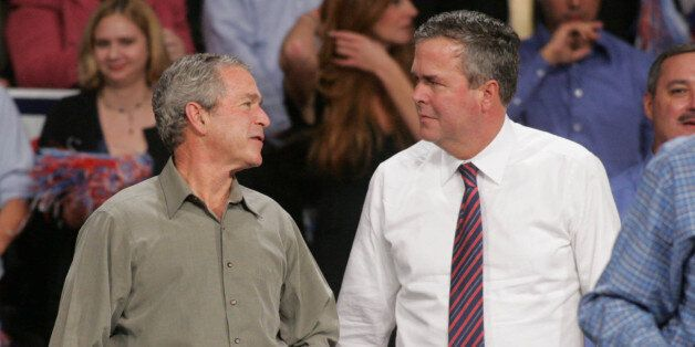 President Bush jokes with his brother Florida Gov. Jeb Bush on Monday, Nov. 6, 2006, in Pensacola, Fla.,...