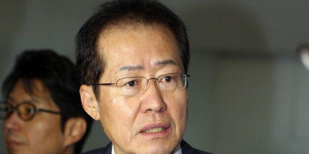 '모래시계 검사' 홍준표 출석 : 檢 '1억 의혹'