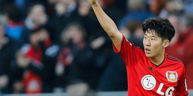 Leverkusen's Son Heung-min from South Korea celebrates scoring his sides third goal during the German...