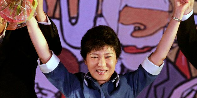 Former Saenuri Party leader Park Guen-hye waves to supporters during a national convention of the ruling...