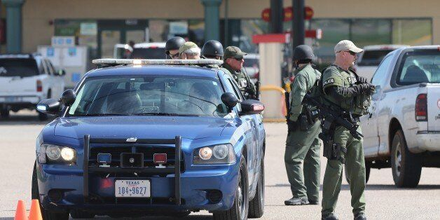 Authorities investigate a shooting in the parking lot of the Twin Peaks restaurant Sunday, May 17, 2015,...