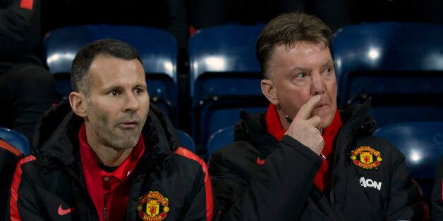 Manchester United's manager Louis van Gaal, right, takes his seat next to assistant manager Ryan Giggs...