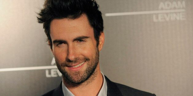 Singer Adam Levine poses at an event debuting his signature fragrances for men and women on Wednesday,...