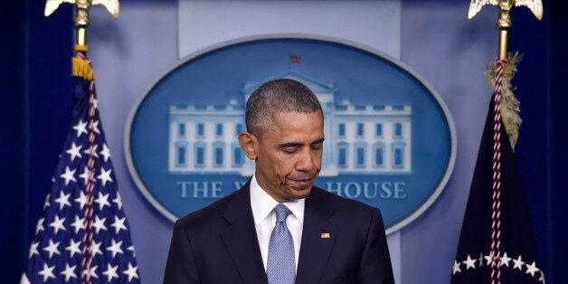 President Barack Obama pauses while speaking in the Brady Press Briefing Room of the White House in Washington,...