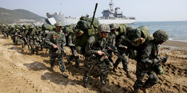 South Korean Marines march after they landed on the beach during the U.S.-South Korea joint landing military...