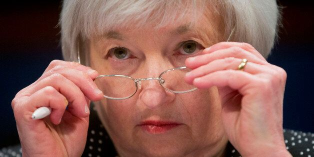 Federal Reserve Chair Janet Yellen removes her glasses as she testifies on Capitol Hill in Washington,...