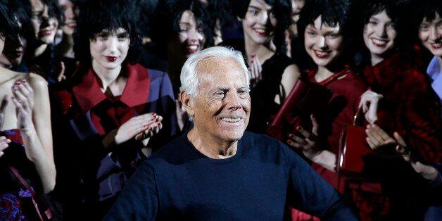 Italian fashion designer Giorgio Armani poses with his models after presenting the Emporio Armani women's...