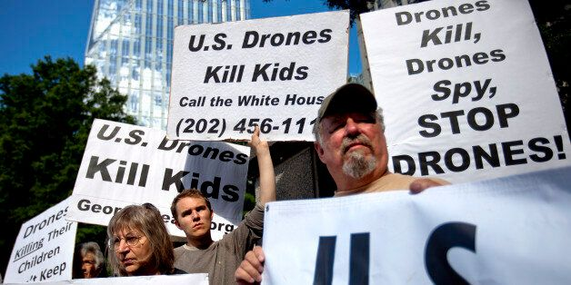 Demonstrators protest against the use of drones outside the International Conference on Unmanned Aircraft...