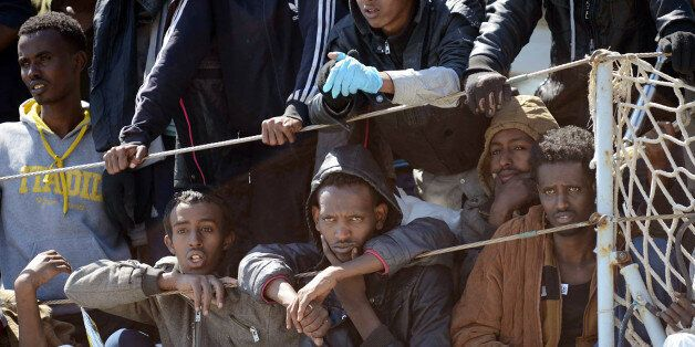Migrants wait to disembark from the Italian Navy vessel 'Chimera' in the harbor of Salerno, Italy, Wednesday,...