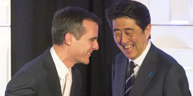 Los Angeles mayor Eric Garcetti, left, and Japanese Prime Minister Shinzo Abe share a laugh at the Investment...