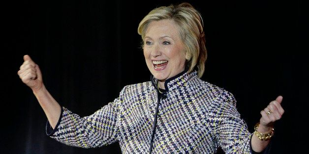 Hillary Rodham Clinton reacts to applause from the crowd before speaking during the sixth annual Women...