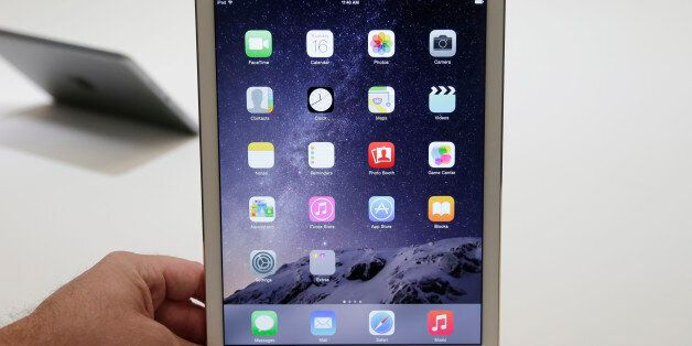 FILE - In this Oct. 16, 2014 file photo, the iPad Air 2 is displayed for journalists at Apple headquarters...