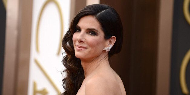 FILE - In this March 2, 2014, file photo, Sandra Bullock arrives at the Oscars at the Dolby Theatre,...