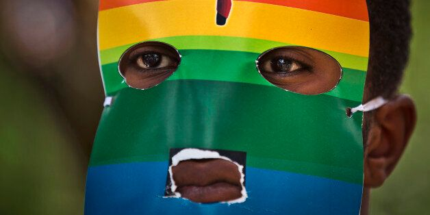 A person wears a mask as Kenyan gays and lesbians and others supporting their cause wear masks to preserve...