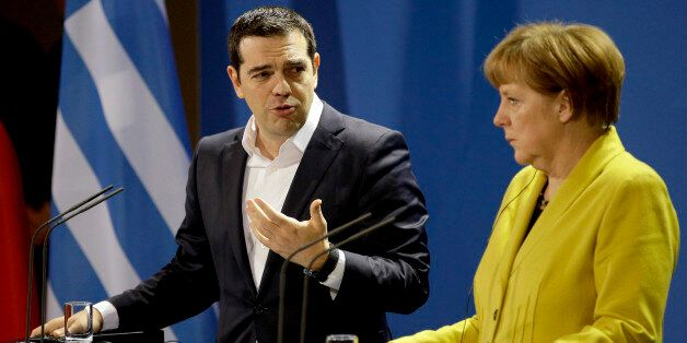 German Chancellor Angela Merkel, right, and the Prime Minister of Greece Alexis Tsipras address the media...