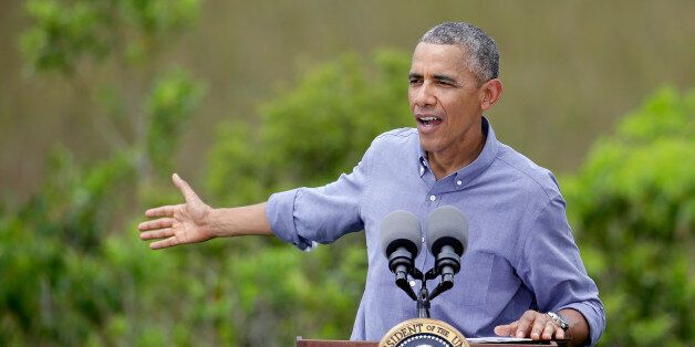 President Barack Obama gestures while making remarks after touring Everglades National Park on Earth...