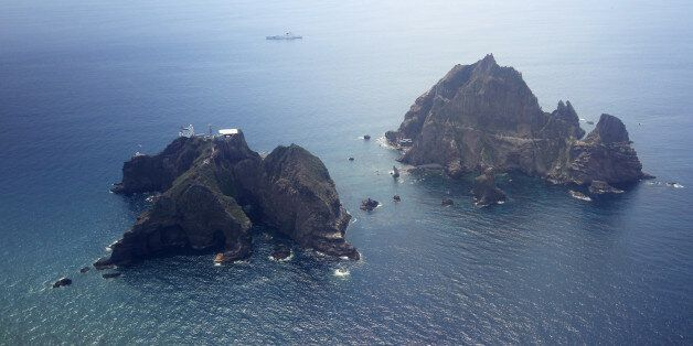 Islands called Dokdo in Korea and Takeshima in Japan are seen Friday, Aug. 10, 2012. South Korean President...