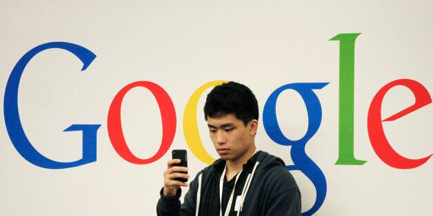 A man uses a cellphone during a seminar for small businesses at Google offices, Oct. 17, 2012 in New...