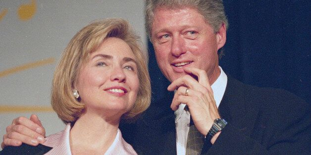 President Bill Clinton and first lady Hillary Rodham Clinton wait to address a group of young Democratic...