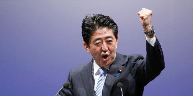 Japan's Prime Minister Shinzo Abe delivers a speech during the Liberal Democratic Party's annual convention...