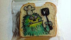 아들을 위해 샌드위치에 그림 그리는