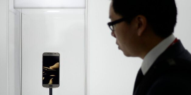 A visitor looks at the new Galaxy S6 during the Mobile World Congress, the world's largest mobile phone...