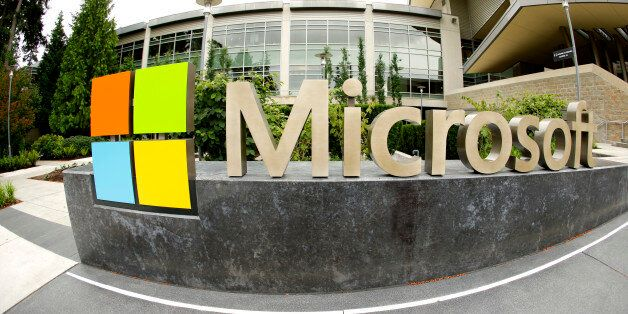 This photo taken with a fisheye lens on July 3, 2014 shows Microsoft Corp. signage outside the Microsoft...
