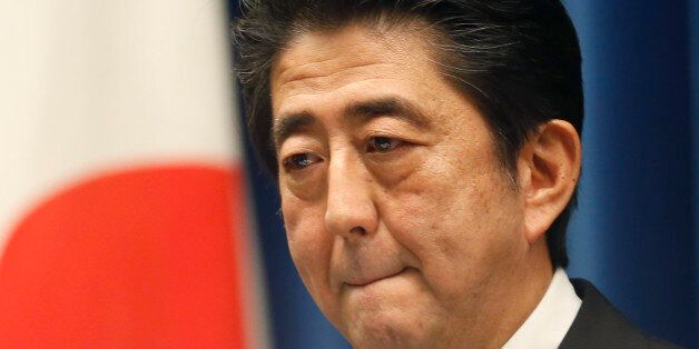 Japan's Prime Minister Shinzo Abe reacts to a question during a press conference at his official residence...