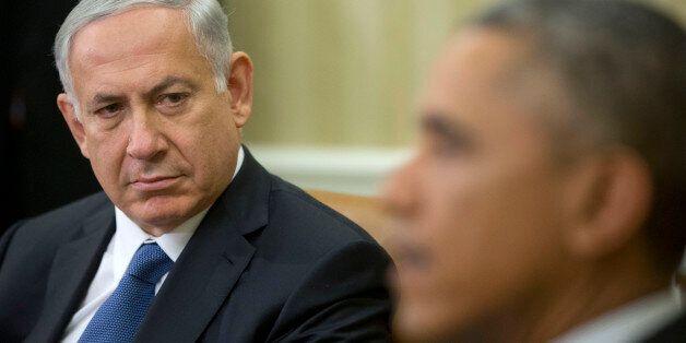 Israeli Prime Minister Benjamin Netanyahu listens as President Barack Obama speaks during their meeting...