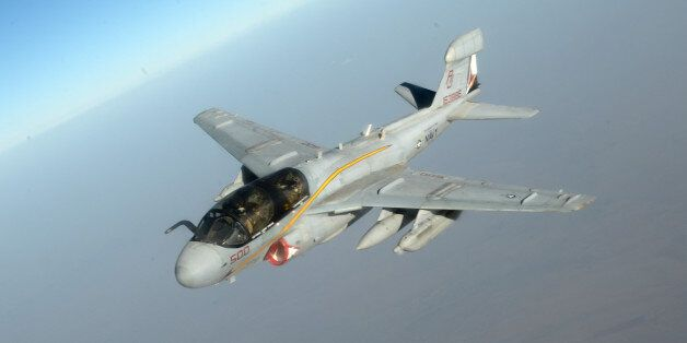 In this Saturday, Oct. 4, 2014 photo released by the U.S. AirForce, a U.S. Navy EA-6B Prowler supporting...