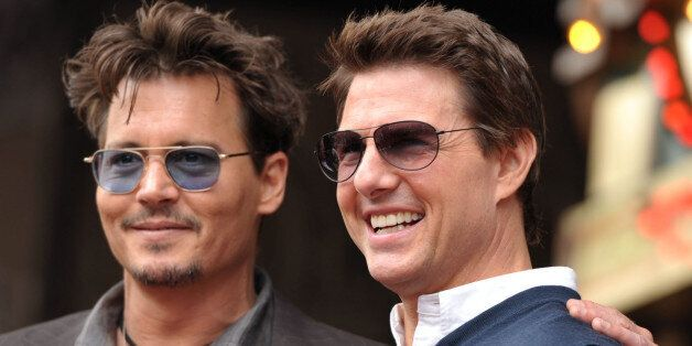 Actors Johnny Depp, left, and Tom Cruise appear at a ceremony honoring film producer Jerry Bruckheimer...