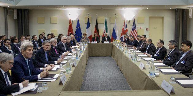 Iranian Foreign Minister Javad Zarif, center right, European Union High Representative Federica Mogherini,...