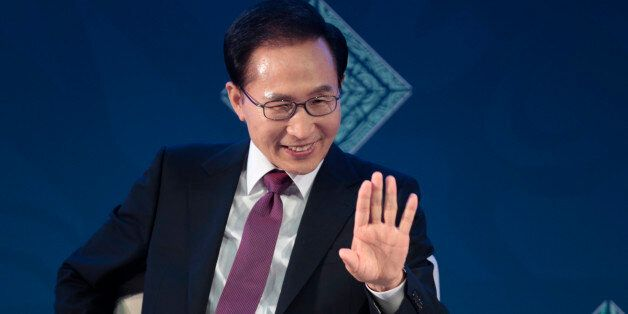 South Korea's President Lee Myung-bak waves as he participates in a panel during a B20 meeting prior...