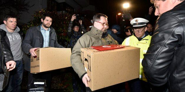 Investigators carry boxes from the apartment of Germanwings airliner jet co-pilot Andreas Lubitz, in...